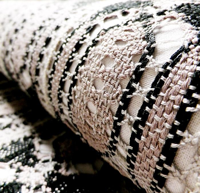 袋帯、本場奄美大島本泥染、網絲織、リバーシブル、裏面生地の質感画像
